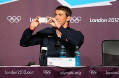 Michael Phelps - now that's funny! Taking a picture of the press at his Press Conference.