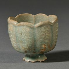 Flower-shaped Celadon Cup, Korea, octofoil, with lobed rim, inlaid with foliate motifs, bluish-green glaze with craquelure, ht. 2 3/4 in.
