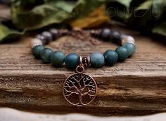A personal favorite from my Etsy shop https://www.etsy.com/listing/467239482/tree-of-life-charm-bracelet-moss-agate