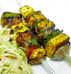 saunfia paneer tikka 200 gms paneer cubes 1/4 capsicum cubes 1 small onion rings 1 tbsp butter For marinade you need: 1 tsp coriander chutney 1/2 tsp mint chutney 1/2 tsp aniseed (saunf) 1/2 tsp honey 1 cup fresh thick curd 4-5 cloves chopped 1 inch ginger minced 4 green chillies finely chopped 1/2 tsp cardamom powder 1 tbsp fresh cream 1/2 tsp lemon juice Salt to taste