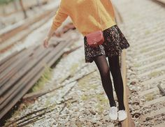 pair a floral skirt with a sweater and tights and oxfords with small purse
