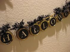Halloween Banner with jar lids...would look great if did something rustic looking for fall
