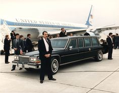 President Reagan speaking from limousine at Columbia airport in Missouri. 3/26/87. ID #C39778-5. http://www.reagan.utexas.edu/archives/photographs/airforceone.html