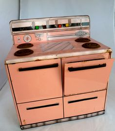 1950s Childs toy stove by Wolverine  Pink and by BitsAndPiecesEtc