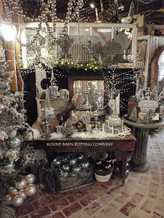 """Pin board """"Boutique Inspiration"""" by Lisa Rentschler Gatz has many examples of great displays and decor.  Shown - Winter display from the Round Barn Potting Company with lots of silver ornaments and garland"""