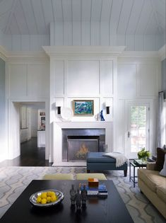 "Not a huge fan of the white ""wood"" paneling on the ceiling, but I love the moulding around the fireplace."