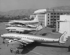 Air Transportation Lineup - The Lockheed family of airliners and transports is shown on the ramp at Burbank, California, circa 1949. At the rear is the mammoth XR6O-1 Constitution double-deck transport for the US Navy. Wedged in the middle (left to right) are a Model 10 Electra, Model 12 Electra Junior, and a Model 18 Lodestar. In the foreground is a Model 749 Constellation that will be delivered to Air France and a Model 1049 Super Constellation that will be delivered to Eastern Air Lines.