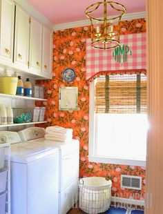 Peonies (Persimmon) wallpaper makes this laundry room so beautiful! Via @paigeminear