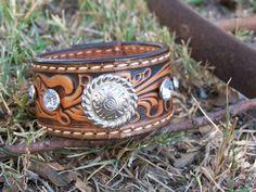 Tooled Leather Cuff  Bracelet Silver Concho adorned with  bling. $20.00, via Etsy.