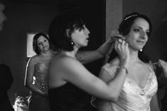 mother of the bride watches the bride gets ready - Elegant Cambridge Mill Wedding | Cidalia and Greg