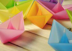 Candles in shape of folded paper boats by artist Roman Ficek.