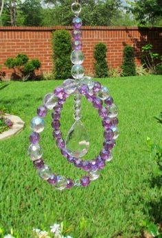 """5  diameter and 7 3/4"""" long. You can make it any size and with any crystal beads.  Sun catchers to hang from a rod in the garden."""