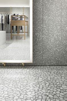 David Chipperfield, Valentino Men's Store, Paris 2013. Terrazzo walls, broken Palladian Marble floors, brass and timber.