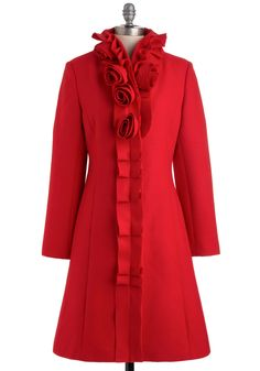 This striking statement coat is exceptionally prim and proper with its pretty collar embellishments!