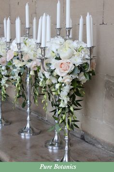 Wedding Table Flowers White peony, hydrangea and blush pink roses on silver candelabras for wedding centrepieces at Warwick Castle. Candelabra Wedding Centerpieces, Candelabra Flowers, Silver Candelabra, Wedding Arrangements, Wedding Table Centerpieces, Flower Centerpieces, Flower Arrangements, Unique Centerpieces, Silver Wedding Decorations