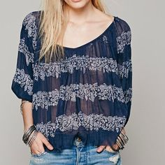 Free People Blouse Sheer oversized peasant blouse with a beautiful print detail. Small crochet accents throughout. Button closures on cuffs. Raw hemline. 100% Rayon Free People Tops Blouses
