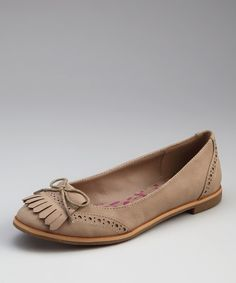 A charming fringed toe-tassel lends this oxford-inspired flat a touch of loafer luxury. The bitty bow and dainty laser-cut detail mix darling with dapper.Man-madeImported