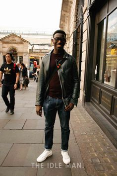 Men's street style | Trendy on Duty - While on duty being trendy can never be a crime, pair up your go to denim with a maroon t-shirt and a leather jacket. | Shop the look at The Idle Man