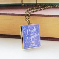 A beautiful dainty Pride and Prejudice book locket. This comes on a bronze tone chain that measures Look great for any occasion and would make the perfect gift for any book lover or Jane Austen fan. Pride And Prejudice Book, Goth Accessories, Any Book, Silver Necklaces, Book Lovers, Arrow Necklace, Gift Wrapping, Books, Cards