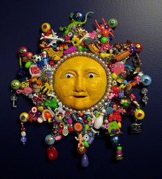 Cool sun mosaic with toy trinkets which can be easily found in charity shops
