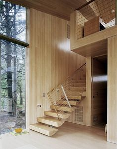 Floating stairs in a cottage in Oakvilee, CT designed by Gray Organschi Architecture