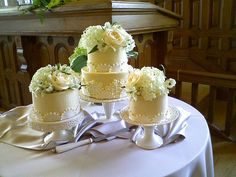 https://flic.kr/p/6Ny3Wd   Miniature Tiered Wedding Cakes   This was an adorable idea for a wedding.  The bride bought these cute stands and the cakes ranged from 4 inches to 8 inches in diameter.  They purchased sheet cakes to make up the rest of the servings.