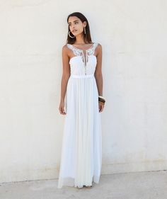 This lovely boho wedding dress is simply chic! from Barzalai on Etsy
