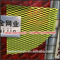 Exterior expanded metal mesh wall cladding