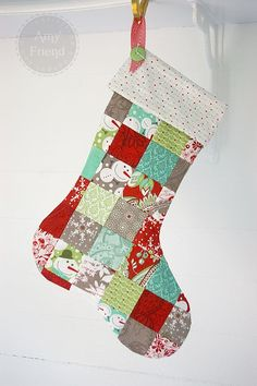 Patchwork Christmas Stocking | Amy Friend-Love how they used the patterns, and the arrangement of the colors