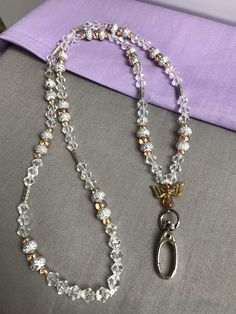 b1c57b4502d6 Clear beaded lanyard with gold tone accents. Lanyard NecklaceBead NecklacesHandmade  NecklacesHandmade JewelryBeaded LanyardsEyeglass HolderId ...