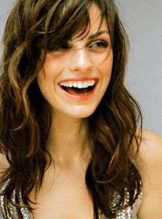 Long Straight Layered Hairstyle With Side Fringe