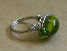This fashionable cocktail ring is easy to make and  looks great too. Your friends will all want one. Be creative by using vintage beads and whimsical adornments. Try coordinating or clashing colours depending on your taste and the seasons popular colours.