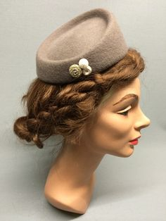 The Dorothy is a versatile little fascinator with a serendipitous quality sure to enliven any gathering. Trimmed with a selection of fun vintage buttons which compliments the subtle felt colour. Colour: Camel #Fabhatrix #Edinburgh #Grassmarket #hat #felt #fascinator #occasion