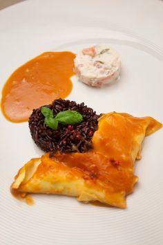 Ravioli van langoustine met zwarte rijst