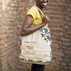 No.41 Signature Bags are handmade with love in Gisenyi, Rwanda. Your purchase not only provides a stable job and sustainable income to a young woman transitioning into a life of independence, you are also providing 240 meals to a secondary student in Rwanda! FOR ONE child, FOR ONE meal, FOR ONE y...