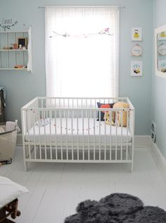 love an all white crib and that sweet baby blue wall color