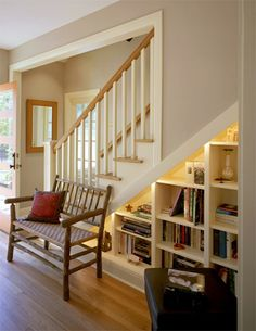 These bookshelves create a small library under the stairs..    via cg design-build