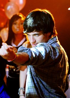 Josh Hutcherson as Clapton Davis in 'Detention' (look at the Girl in the Background lol)
