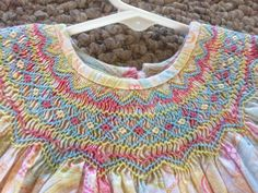 Rainbow colored smocking on bishop dress.