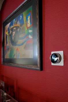 """NEST smart thermostat, learns your home temperature setting habits, adjusts for """"away time"""" and can even be controlled by smart phone."""