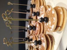 For Alisha's baby shower Dollar shape pancakes layered with nutela, sprinkled with powdered sugar, topped with blueberries!! Delicious!