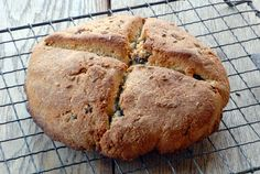This healthy gluten-free and paleo Irish Soda Bread recipe is made with almond flour, raisins, apple cider vinegar and caraway seeds.
