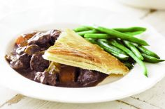 Beef burgundy is a classic stew that tastes even better baked inside a puff pastry crust.