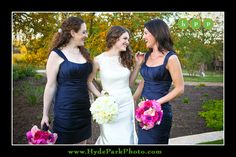 The bride poses with two of her bridemaids in their navy royal blue dresses. Hot Pink and White bouquets really pop in this Austin, Texas Hill Country wedding at Austin Wedding and Events Venue, Camp Lucy. Photos by Austin Wedding Photographer Hyde Park Photography. www.hydeparkphoto.com @Camp Lucy