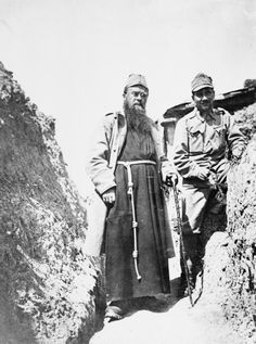 Father Cajus, regimental chaplain of a Tyrolean Rifle Regiment (Tiroler Kaiserjägerregiment), in trenches on the Italian Front. 1916.
