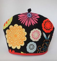 colorful floral tea cozy from http://www.etsy.com/shop/RedLeafStitchCraft?ref=seller_info