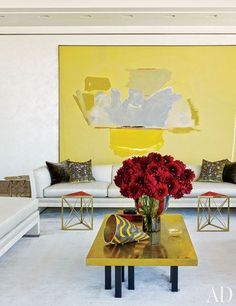 large oversized yellow abstract artwork in super contemporary eclectic living room | residential interior design ideas