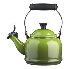 Love this--would love an entire Le Creuset set in spinach for my new kitchen... color pops against greys and browns.