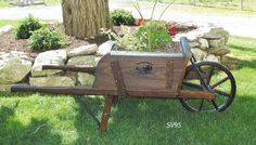 Old Fashioned Reproduction Wooden Wheelbarrows