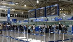Two men, one disguised as a female, arrested at airport after attempting to fly to Vienna